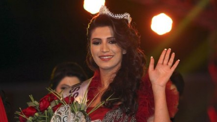 Finek Mohammad Abdul Kareem smiles and waves after being crowned Miss Kurdistan Region 2013 in the city of Arbil